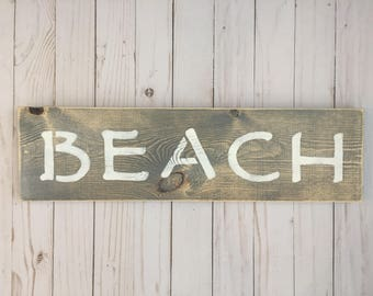 Distressed wooden beach sign