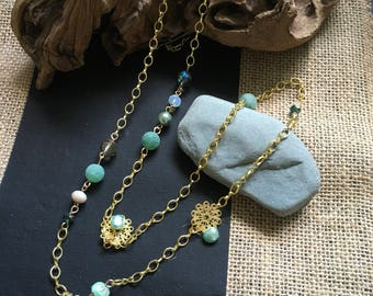 Gold necklace turquoise, and smoke colored beads.