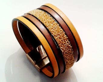 mustard yellow leather cuff and caviar gold clasp gold