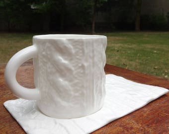 Porcelain cup and saucer braid pattern
