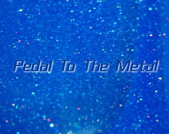 Pedal To The Metal glitter nail polish 15 mL (.5 oz) from the Quest Collection