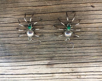 Vintage sterling silver spider earring, with a green stone