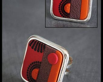 Black square ring / raspberry / orange / taupe patterned polymer