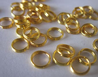 50 double 6 mm gold colored metal rings