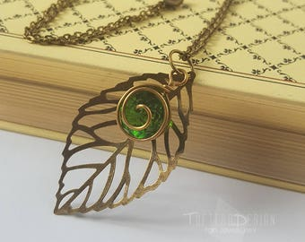 kokiri emerald necklace, legend of zelda ocarina of time spiritual stone kokiki emerald necklace, korok leaf kokiri emerald forest necklace