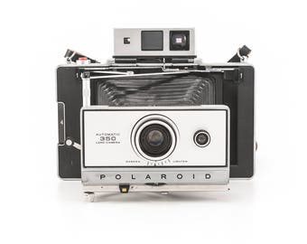POLAROID Automatic 350 Land Camera with AAA battery conversion and manual - uses fuji 100c or 3000b - film tested and working