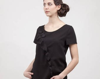 Black crepe with ornamental flowers and ruffle blouse