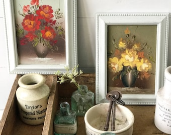 A pair of pretty original oil paintings mounted in frames