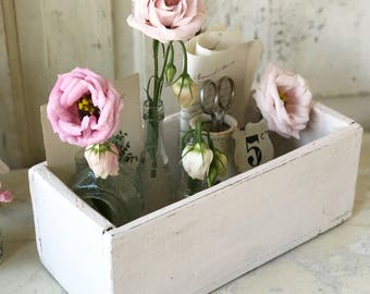 A lovely chippy painted pale pink wooden box