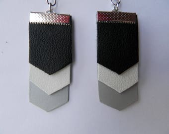 Black leather, white and grey earrings