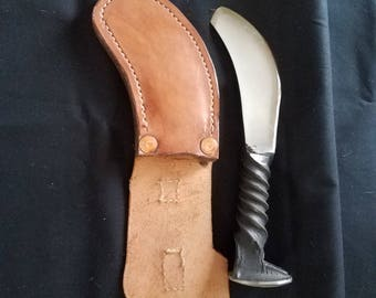 Hand forged knife, leather hand tooled sheath