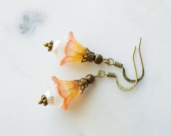 Earrings, yellow and pink lucite flower dangle earrings