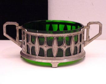 art deco pewter bottle stand with green optical blown liner