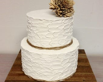 Very rustic cake.  Rustic cake.  Two tier cake. Non edible materials.