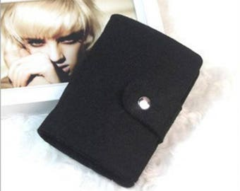 X 1 black business card holder made of wool felt