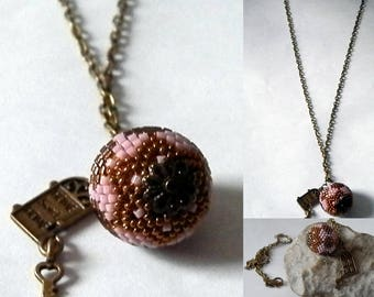 bronze and pink beaded Ball pendant