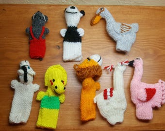 Eight whimsical handmade wool finger puppets in the shapes of animals both familiar and ferocious --  several both at the same time