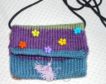 knitted by hand with a shoulder strap and lined pouch