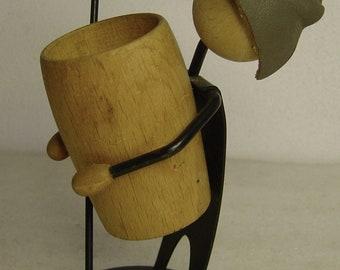 cute wood + black metal figurine holder for saltsticks and bretzels