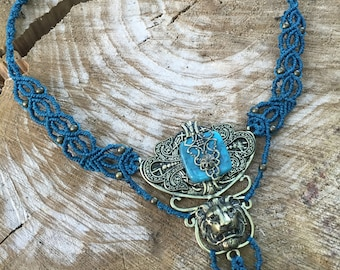 Petrol blue macrame necklace with a big lion metal stamping