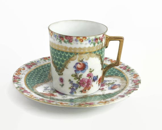 Vintage demitasse cup and saucer, very pretty multi colored floral pattern with lots of gilt, 90 mls