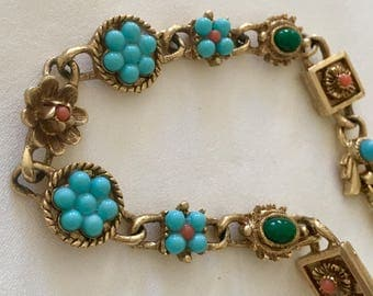 Gorgeous Vintage Turquoise Glass, Coral , and Green Glass Bracelet. 7 1/2 Inches Long and So Pretty. Gold toned.