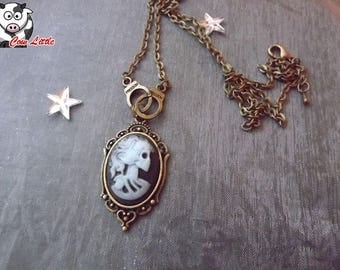 Cuffs and blue skeleton woman cameo bronze necklace