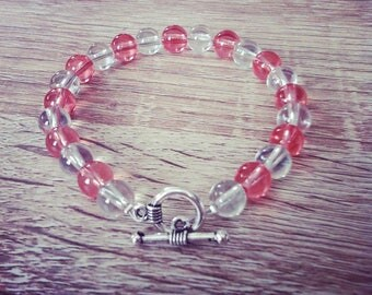 Non-elastic bracelet in coral and clear glass beads