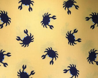 Blue crabs on yellow fabric.  Jack and Lulu for Dear Stella