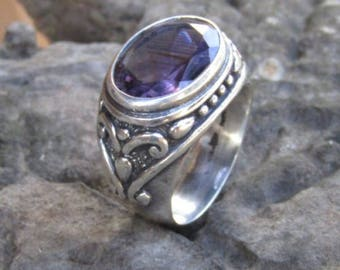 Silver ring traditional motif with amethys stone