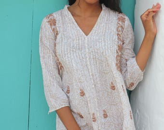 White and rosa Ibiza tunic dress in muslin cotton with hand embroidery