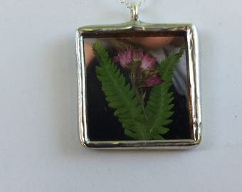 Hand crafted stained glass pendant made with real pressed flowers on a .925 silver plated chain