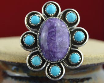 Sterling silver flower ring with turquoise stones surrounding a charoite stone sz 7