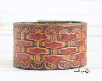 CUSTOM HANDSTAMPED brown leather cuff with woven design by mothercuffer
