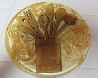 Beautiful Vintage Lucite Hot Plate Pad With Straw And Wood Canister Filled With Kitchen Wood Spoons Design
