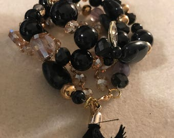 Black and Gold Mix Bead Bracelet With Tassel