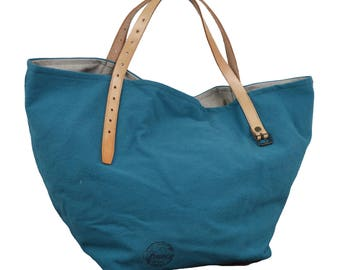 Blue purse with leather handles