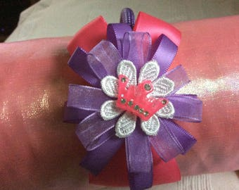 Pink & lilac handmade ribbon flower on a woven headband.