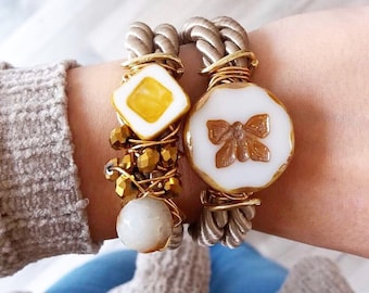 Butterfly and gold beaded taupe bracelet