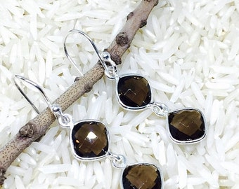 10% Smokey topaz earrins set in sterling sliver 92.5. Perfectly matched Natural smokey topaz stones. Length-1.20 inch long.