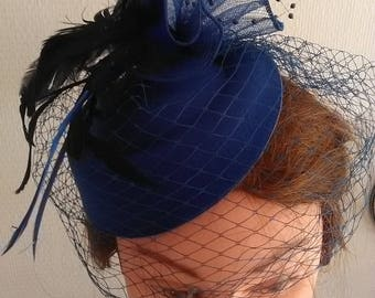 Dark blue with veil fascinator
