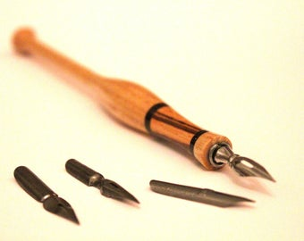 Dip pen with extra nibs