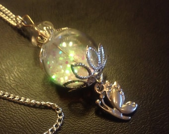 Chain pixie dust in glass ball