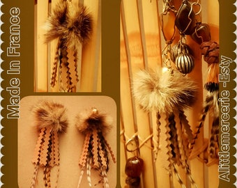 2 leather tassels fur feathers