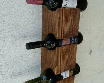 Wall wine rack for four bottles