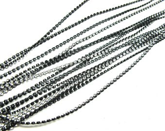 30 CMS CRYSTAL RHINESTONE TRIM HAS SEW ENTRENCHED IN CHAIN BACKED BY A BLACK 2 MILLEMETRES 30CM BY 30CM