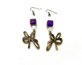 Bronze bow earrings purple and white beads