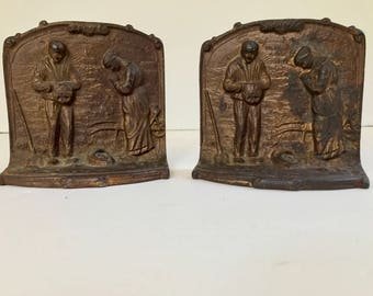 Arts and Crafts cast iron bookends