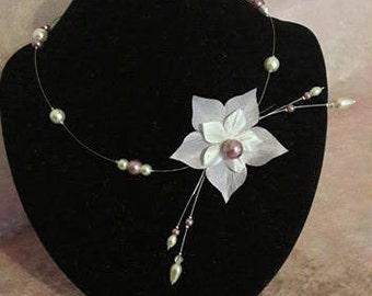 Necklace with a purple and white silk flower