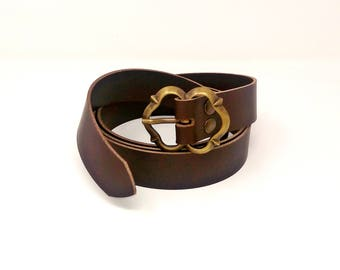 Leather belt with decorated metal buckle. For historical, medieval, fantasy, LARP, Cosplay, casual clothing, boho-chic
